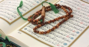 Holy Qur'an with wooden rosary
